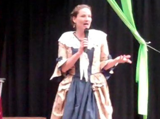 Operetta! A World Tour: Singer in 18th Century costume with microphone.