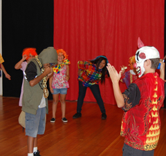Poetry to Song Children performing on stage in costume